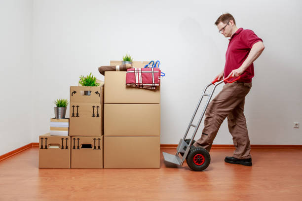 Man is packing boxes on a sack barrow stock photo
