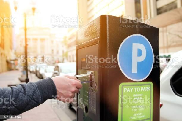 Man is paying his parking using credit card at parking pay station picture id1071972296?b=1&k=6&m=1071972296&s=612x612&h=5filsh44quqjoz1l2rwdnhekgbls 0p1tktys2k4rqk=
