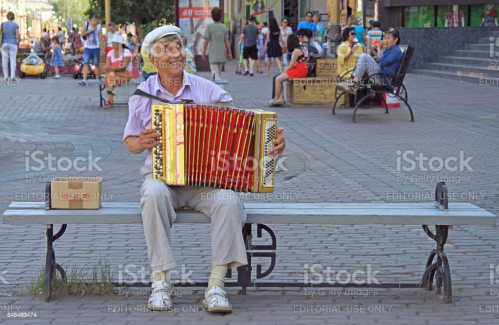 man is playing bayan outdoor in Ulan Ude, Russia stock photo