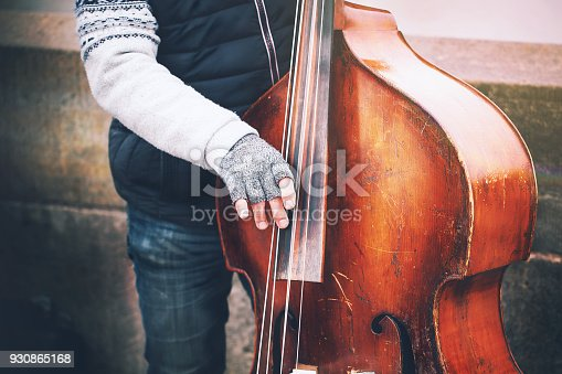 istock man is playing cello in the street. 930865168