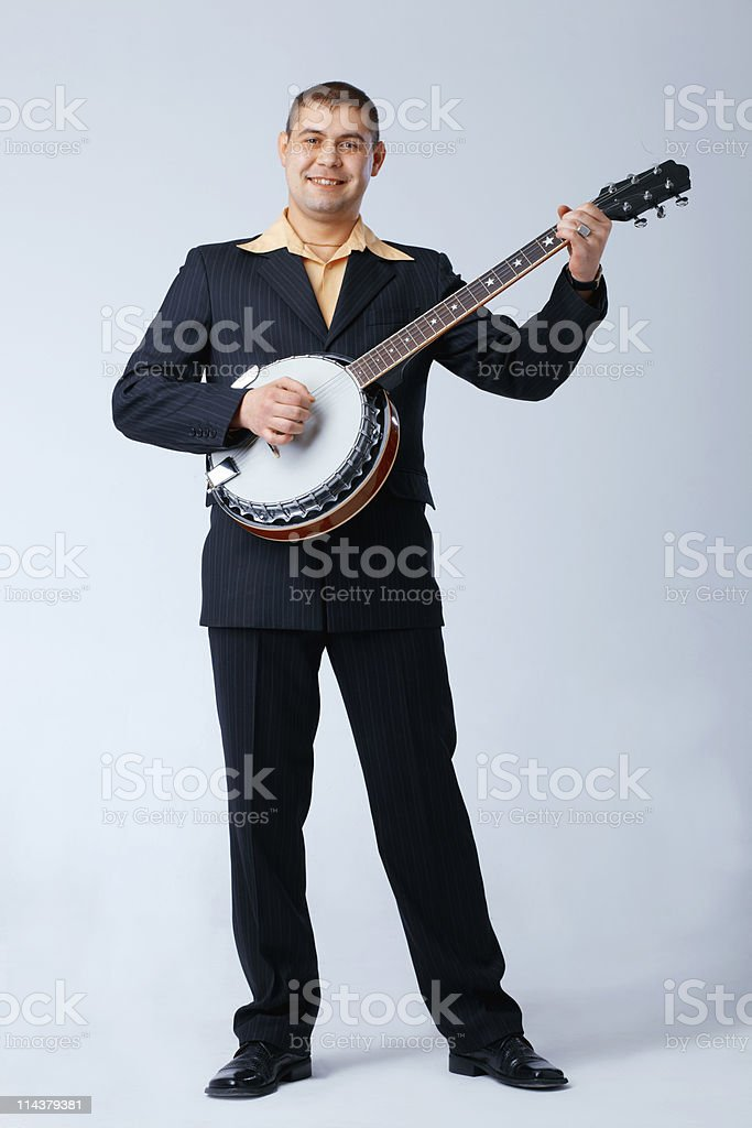 Man Is Playing on Banjo. stock photo