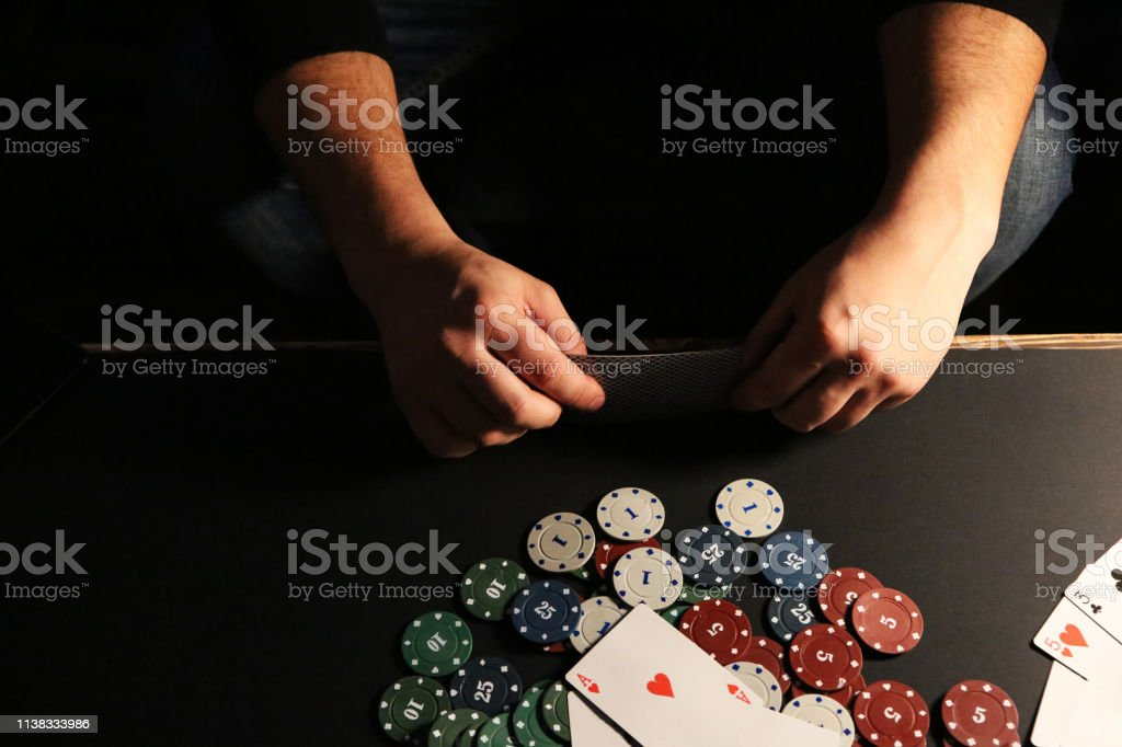 Man is playing poker. Gamble gaming. Free time hobby. Hands over the...