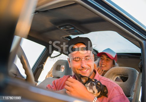 937331052istockphoto A man is playing with a dog 1157801593