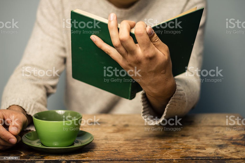 Man is reading and having coffee royalty-free stock photo