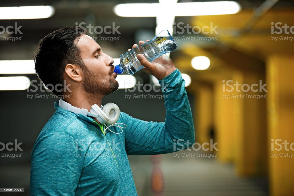 Man is relaxing after training stock photo