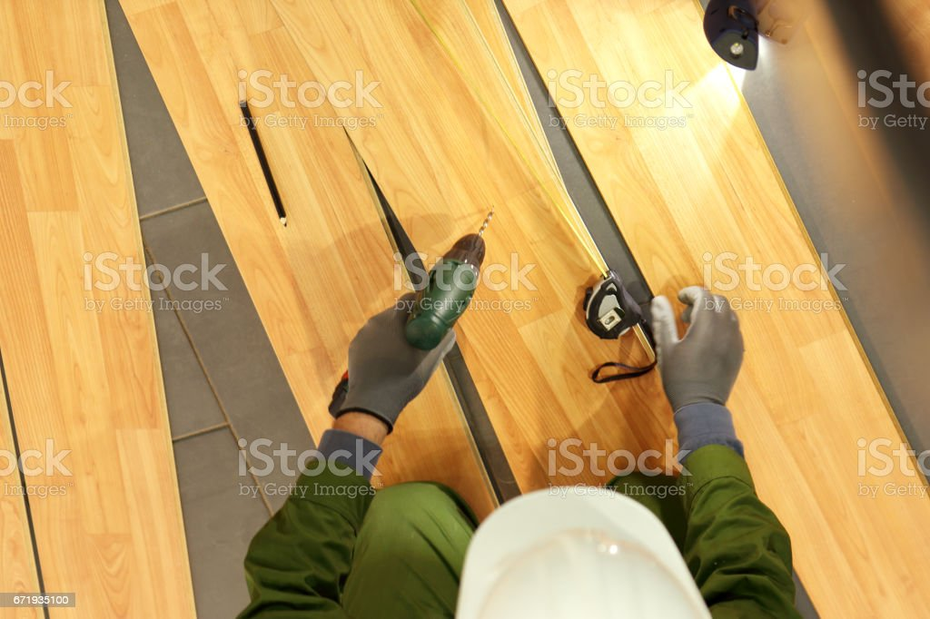 Man is repairing the floor stock photo