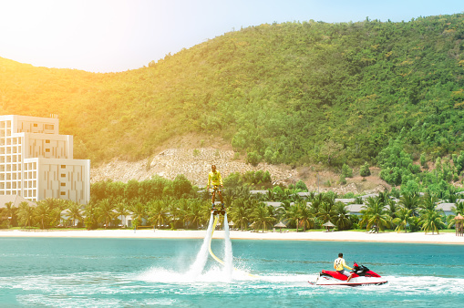 istock Man is riding a flyboard. 1139443808