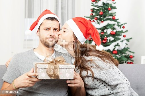 istock man is sceptical about christmas gift 618346714