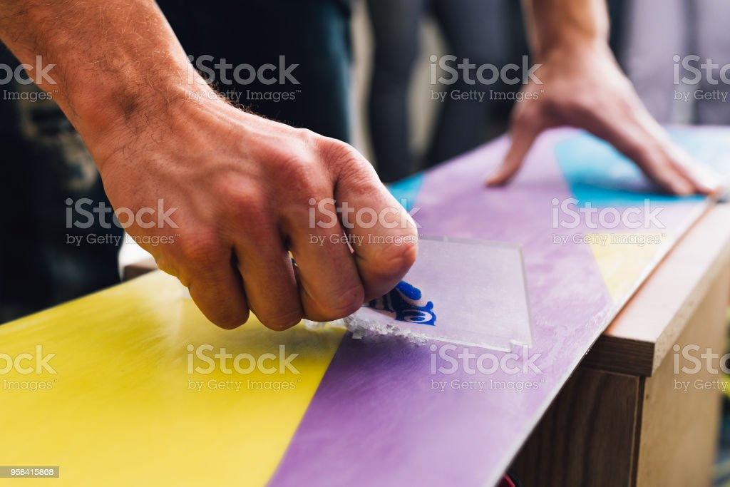 man is scratching and scrabing a snowboard stock photo