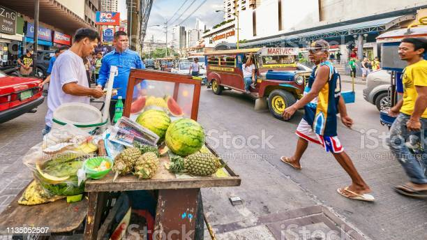 Man is selling pineapple and watermelon from his fruit stand on the picture id1135052507?b=1&k=6&m=1135052507&s=612x612&h=29w2kxfynxc1norszwqnn7hnrgsaaqm wy5e wahd1y=