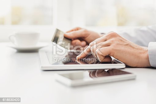 istock Man is shopping online 618530420