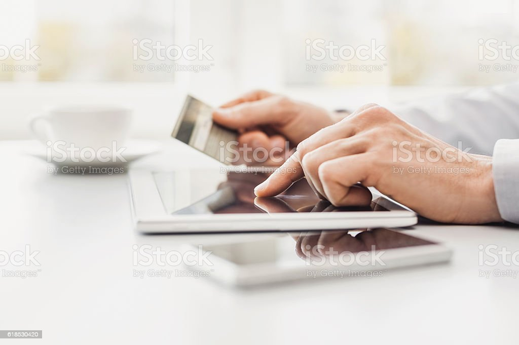 Man is shopping online bildbanksfoto