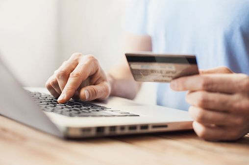 Man Is Shopping Online With Laptop Stock Photo - Download Image Now