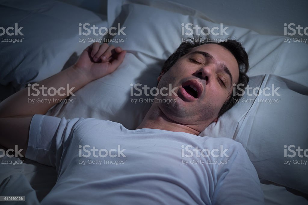 Man Prepares To Go To Bed And Sleep. Person Lays Down In ...   Man Sleeping In Bed At Night