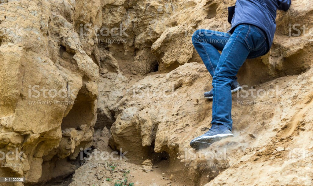 Man is slipping from a slope stock photo