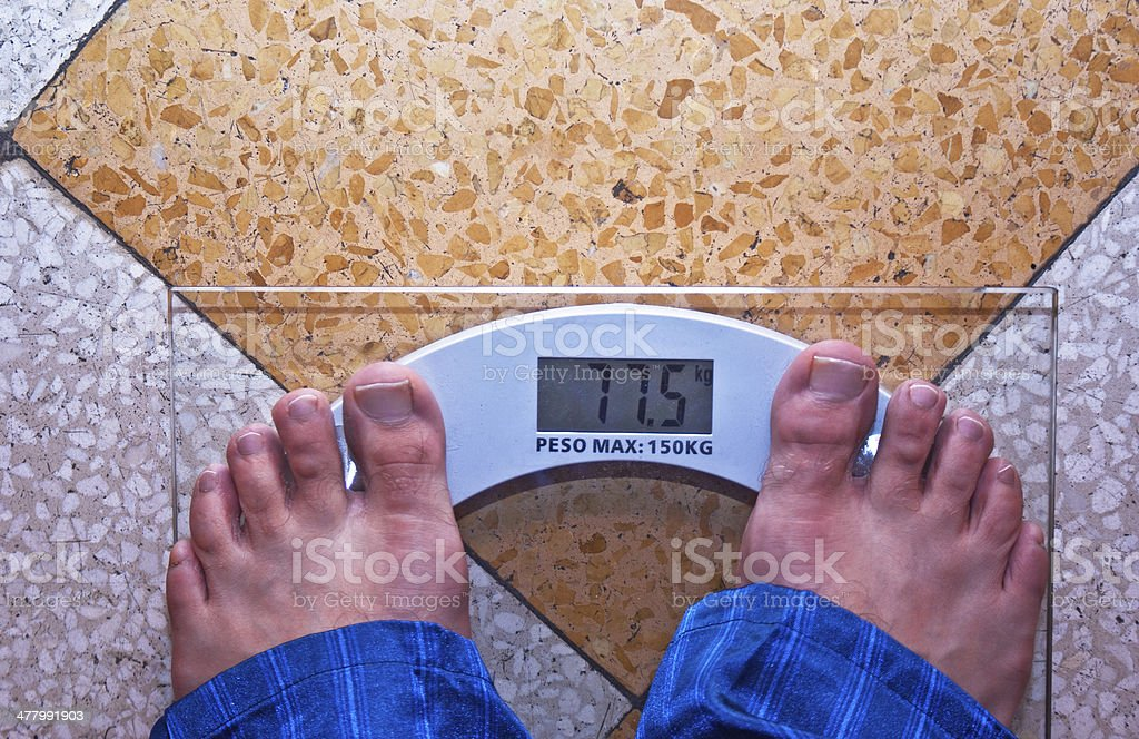 man is standing on a scale royalty-free stock photo