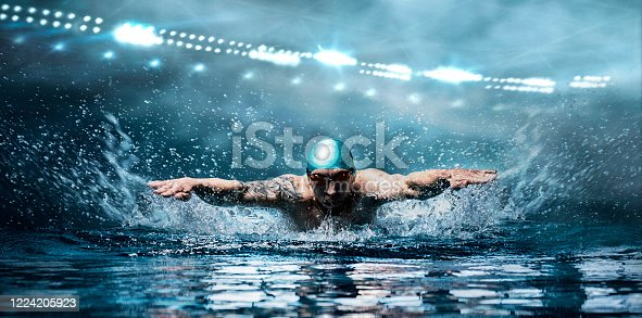Man is swimming breaststroke. Water sports concept. Mixed media