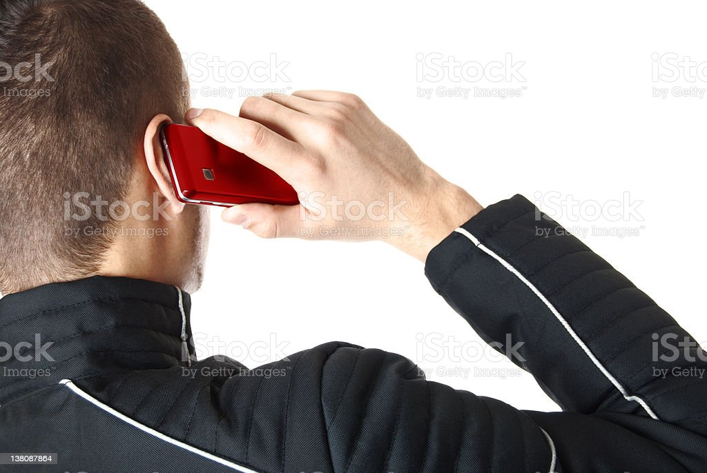 Man is talking on red smart phone | Isolated stock photo