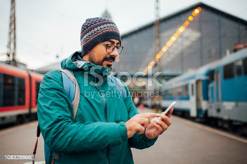 Man is texting at train station