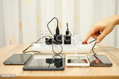 istock man is turning off  power adapters for mobile phones 502396726