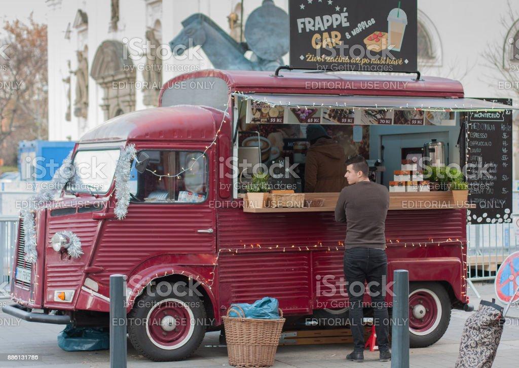 Man is waiting in front of mobile food van stock photo