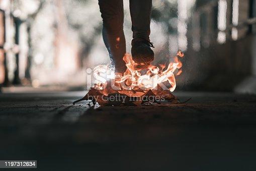 A man is walk across the bonfire.