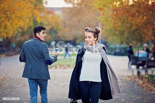 Man is walking in the city and turning around a beautiful girl