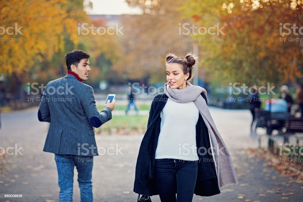 Man is walking in the city and turning around a beautiful girl stock photo