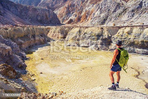 Man is watching Valley of crater Stefanos, Nisyros island