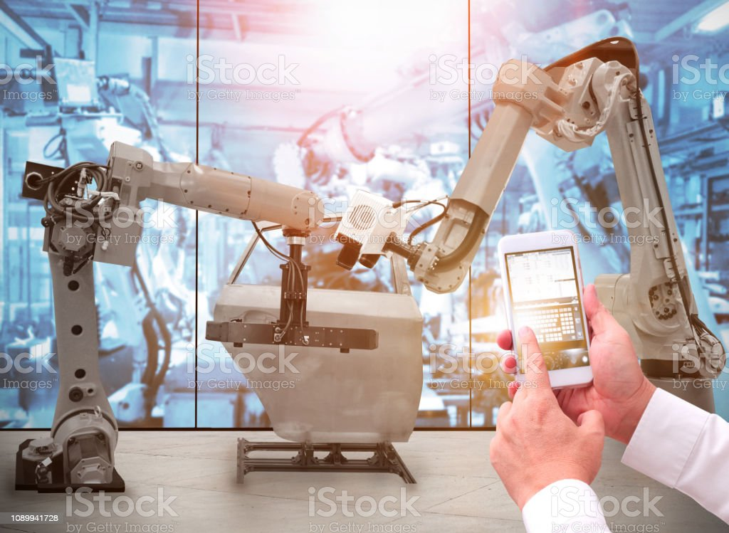 Man is working with Robot stock photo