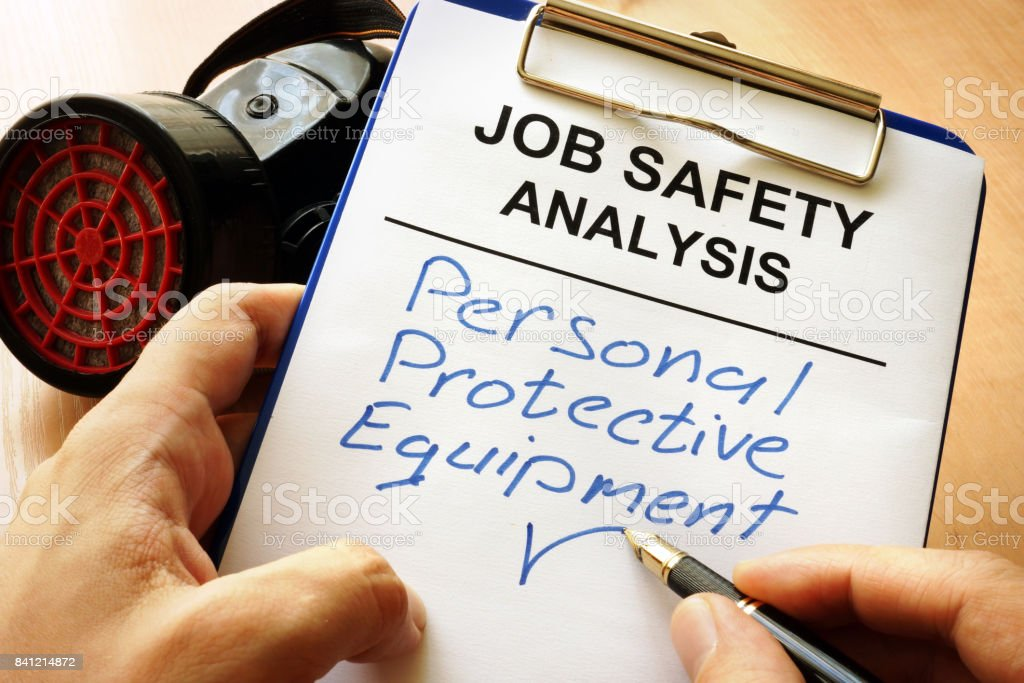 Man is writing words Personal protective equipment (PPE). royalty-free stock photo
