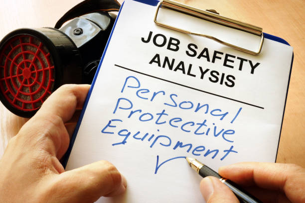 Man is writing words Personal protective equipment (PPE). stock photo