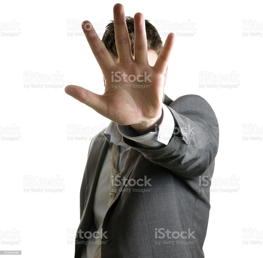 Man isolated on white tries to block or stop people royalty-free stock photo