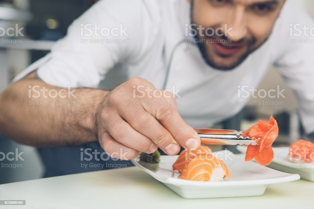 Man japanese restaurant chef cooking in the kitchen stock photo