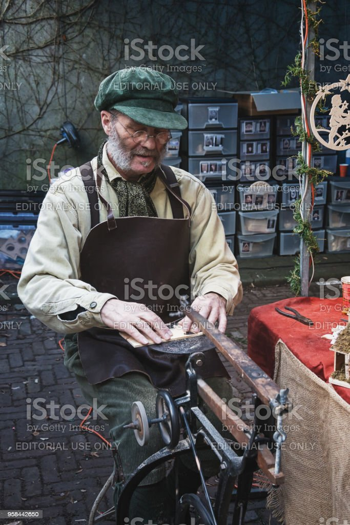 Man jigsawing at the Dickens Festval in Deventer stock photo
