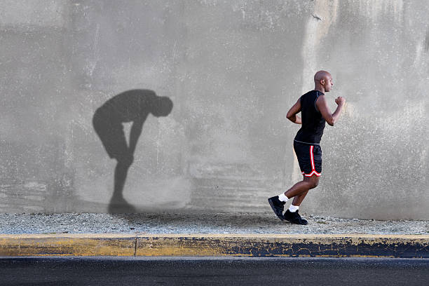 Man Jogging and Tired Shadow stock photo
