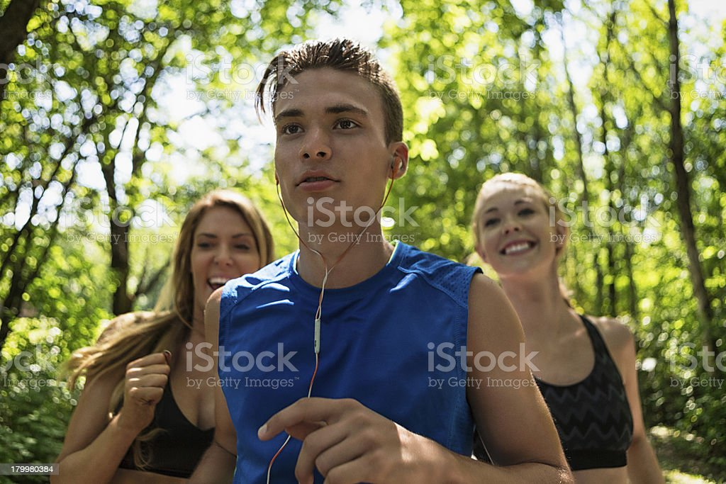 Man Jogging In Front Of Woman royalty-free stock photo