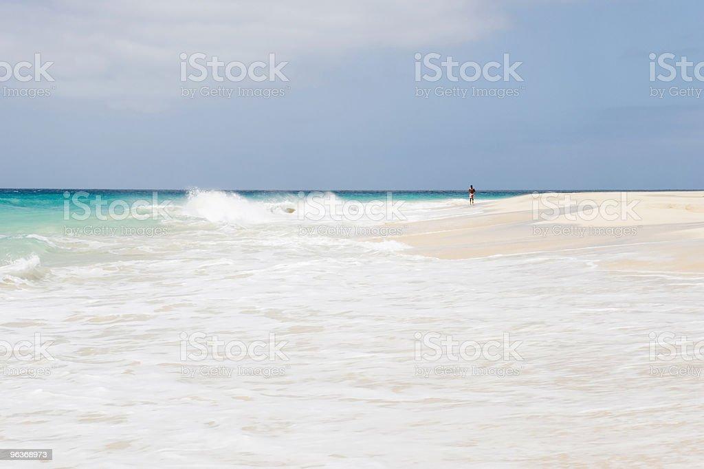 man jogging on beautiful beach royalty-free stock photo