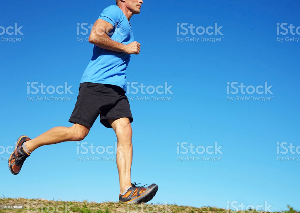 Man Jogging On Field stock photo
