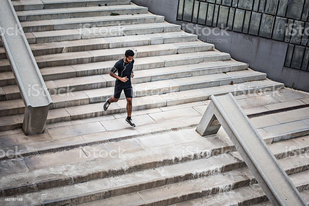 Man jogging on stairs stock photo