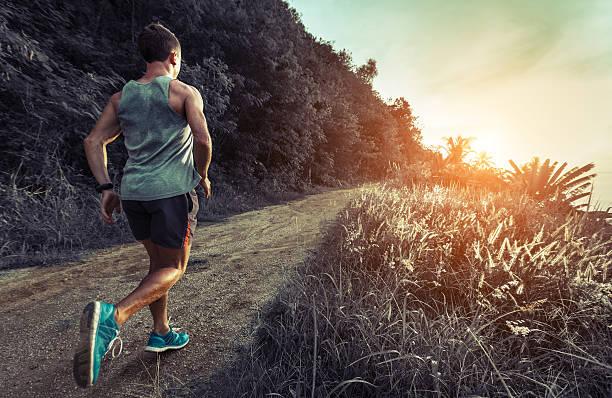 man jogging on the road - jogging hill bildbanksfoton och bilder