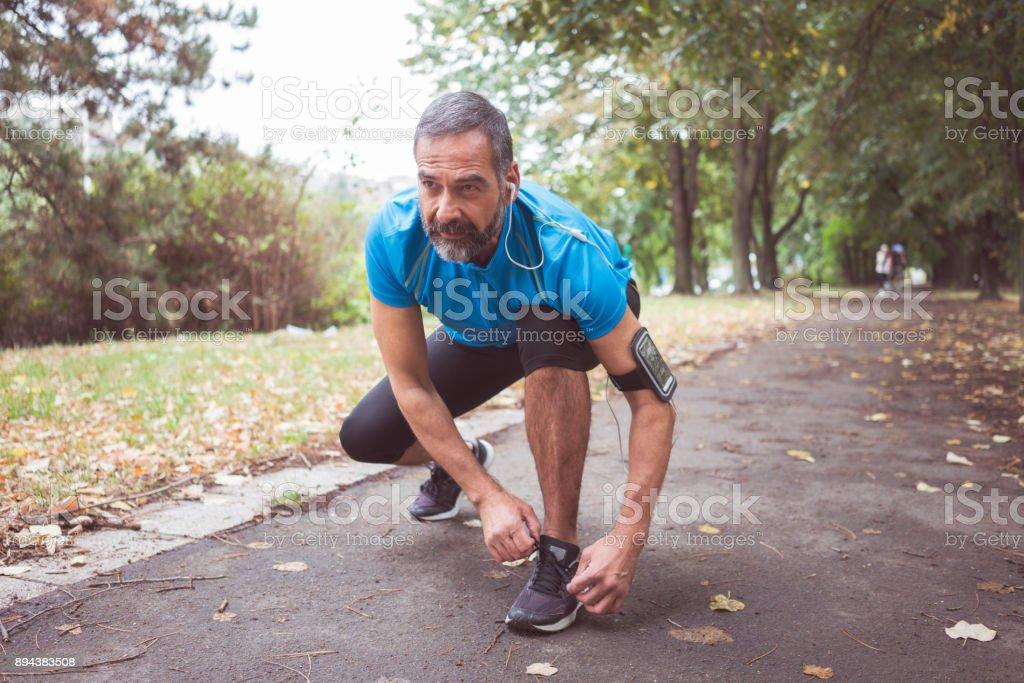 Man jogging outdoors stock photo