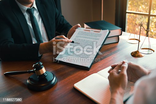 182148217istockphoto Man judge is currently advising clients on their requests for legal proceedings and legal advice. 1188527380