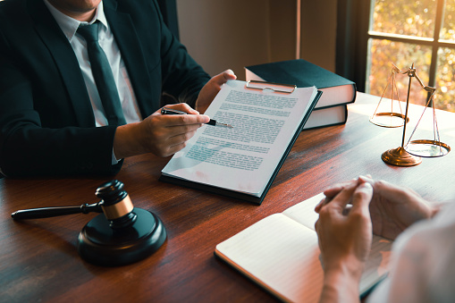 182148217 istock photo Man judge is currently advising clients on their requests for legal proceedings and legal advice. 1188527380
