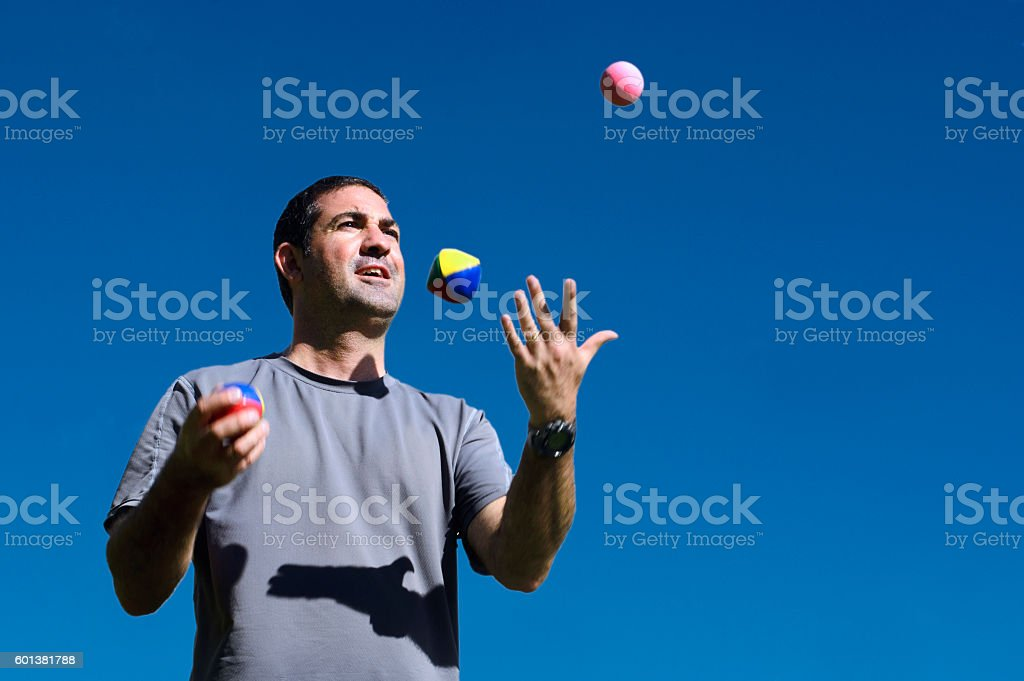Man Juggling Balls stock photo