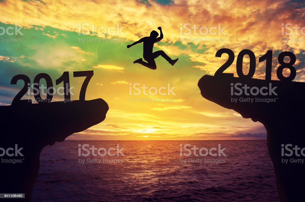 A man jump between 2017 and 2018 years. – Foto