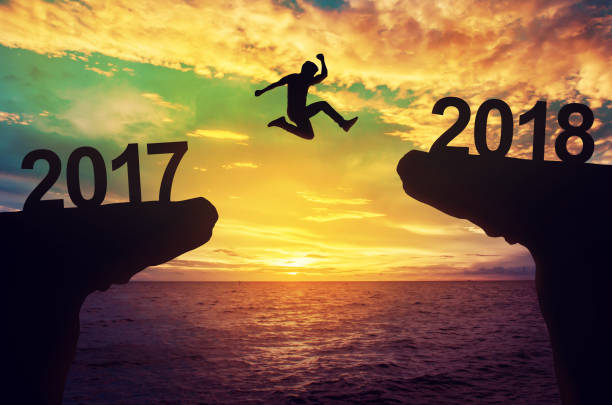 A man jump between 2017 and 2018 years. stock photo