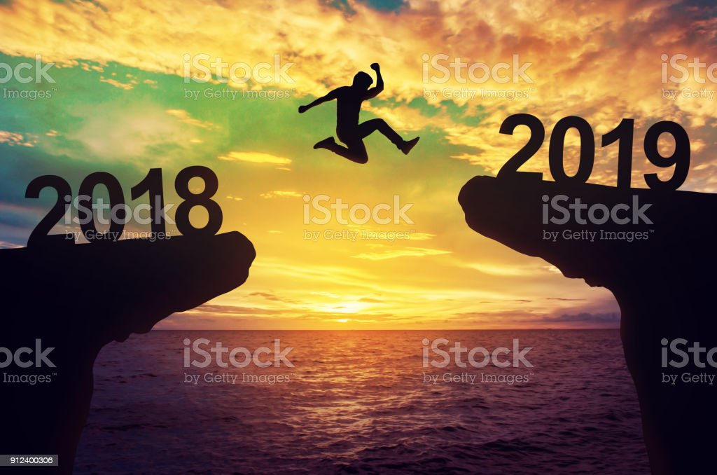 A man jump between 2018 and 2019 years. stock photo