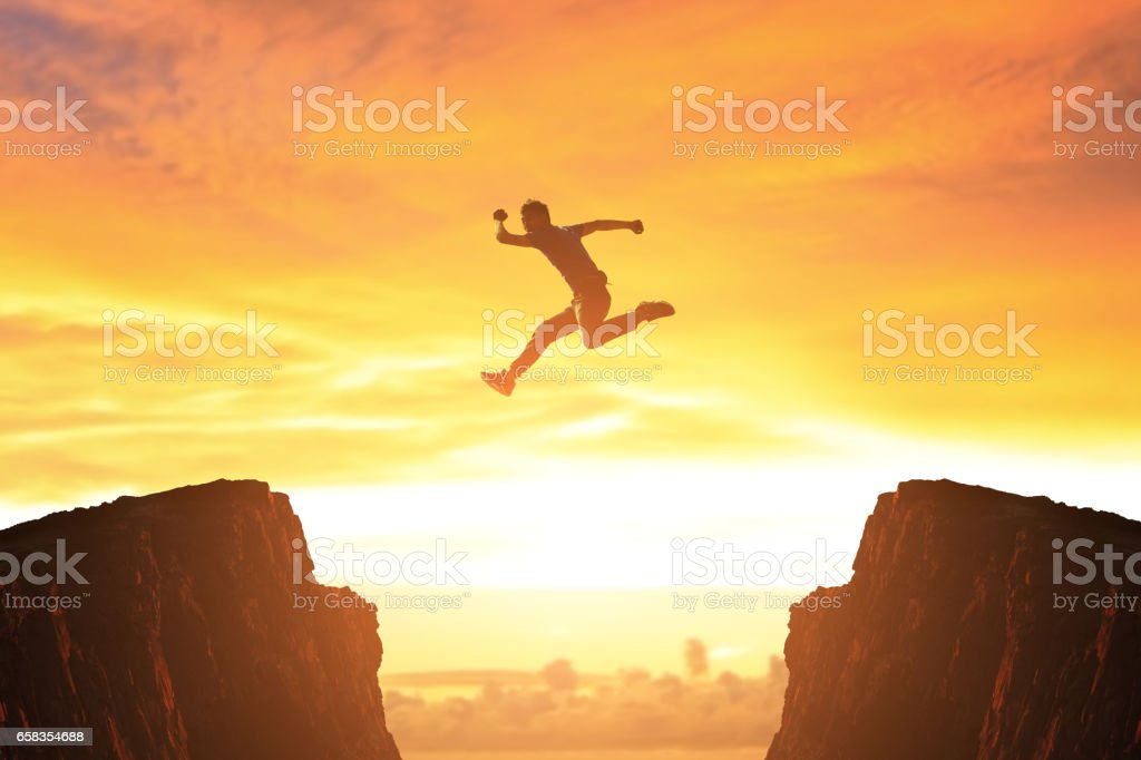 man jump in moutain stock photo