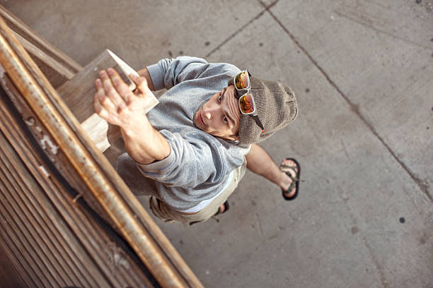 man jumping and climbing - daredevil stock pictures, royalty-free photos & images